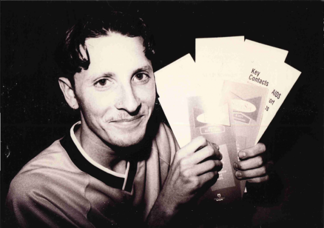 Unidentified man with Minnesota AIDS Project literature