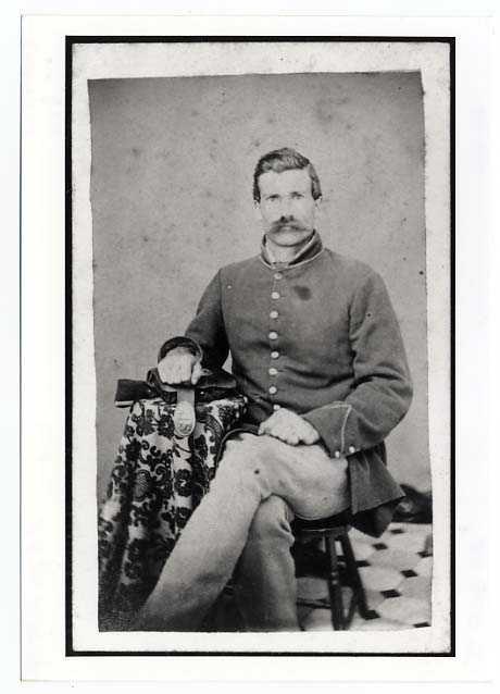 Black and white Carte-de-visite of Archibald Calquhoun, Private, Eleventh Minnesota Infantry Regiment, Company D., taken in 1864 or 1865.