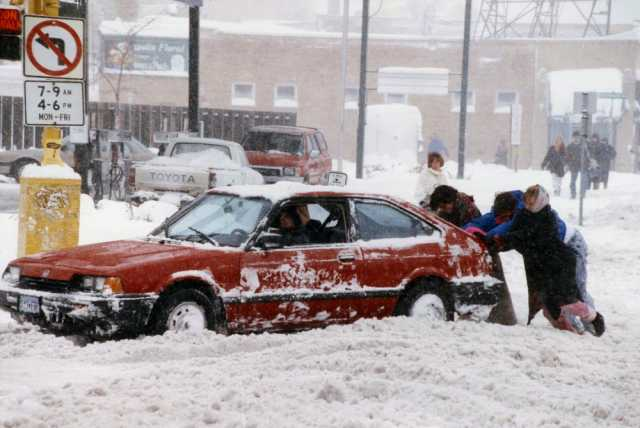 Color image of a car stuck in the snow during the Halloween Blizzard, 1991. Photograph by Duane Braley, Minneapolis Star Tribune.