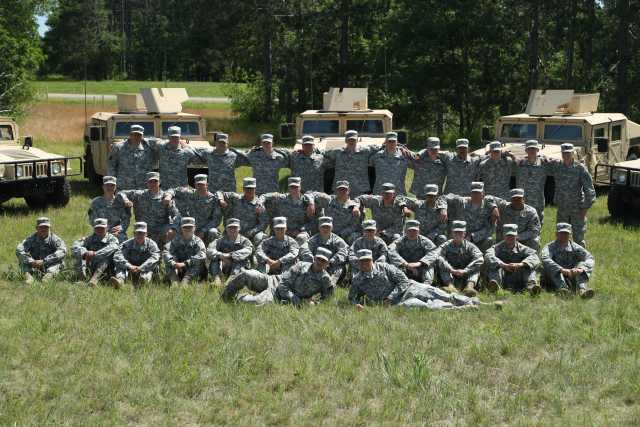 Color image of a platoon of the 34th Military Police Company, 34th Infantry Division, during annual field training at Camp Ripley, June 2016.