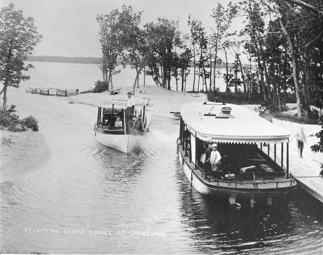 photograph of two boats on a river