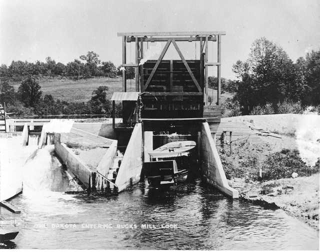 photograph of a steamboat going through a lock on the Pelican River