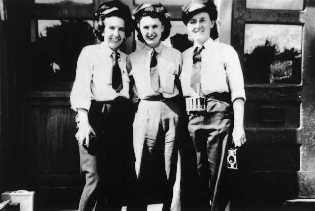 photograph of three uniformed motorettes