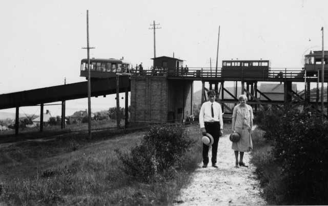 A couple posed in front of the top of the Incline station