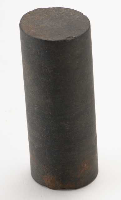A piece of drill core used by E. J. Longyear near Mesabi station, ca. 1890. The piece measures approximately two and a half inches long and about one and an eighth inches in diameter.