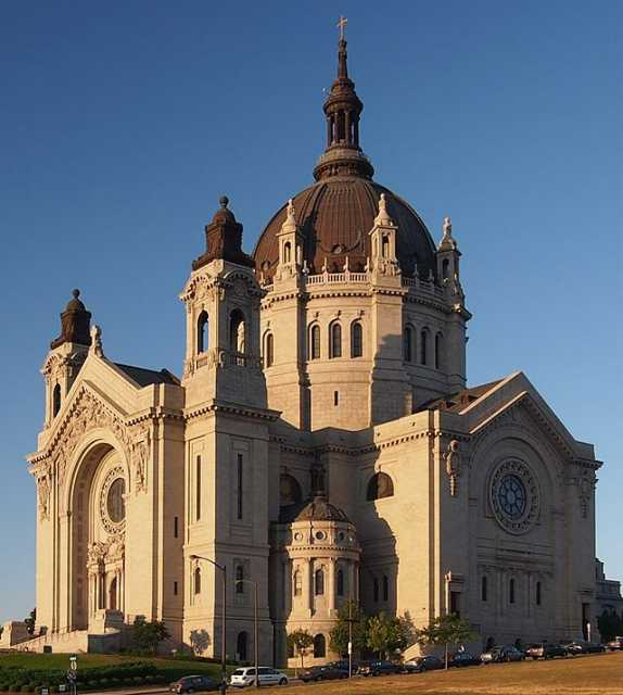 Color image of the of St. Paul Cathedral from John Ireland Blvd. Photograph by Wikimedia Commons user McGhiever, 2012.