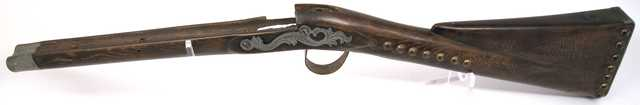 Color image of a musket stock used by the North West Fur Company. Made between 1790 and 1800.