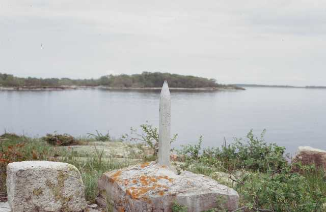 Color photograph of monument marking the northwest point of Lake of the Woods on Rose Island.