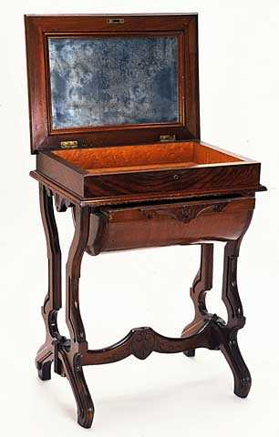 Color image of a Walnut sewing table used by Harriet Bishop. Created in 1850.