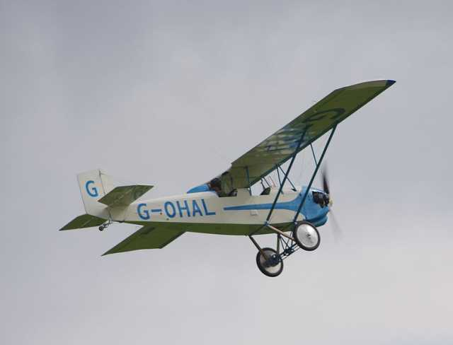 Color photograph of Pietenpol Air Camper G-OHAL, Continental C90-14F powered, built 2008, flying at Old Warden on September 7, 2008.