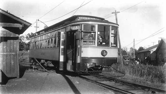 photograph of a streetcar at a station