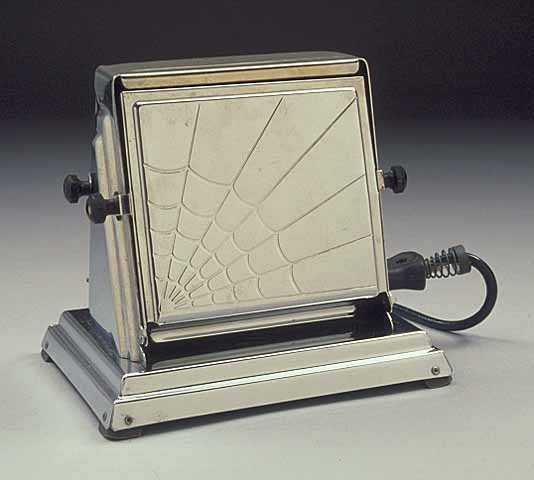 Color image of a General Electric two-slice toaster and cord, ca. 1930s