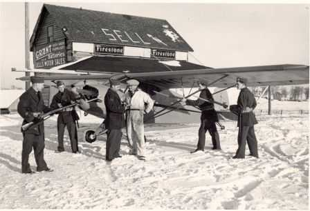 Black and white photograph of Elmer Sell and Minnesota Home Defense at Sell Airfield.