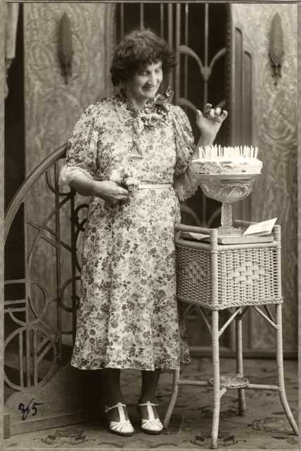 Black and white photograph of Susie Schmitt Hanson pictured at age eighty-five with a birthday cake, c.1945.