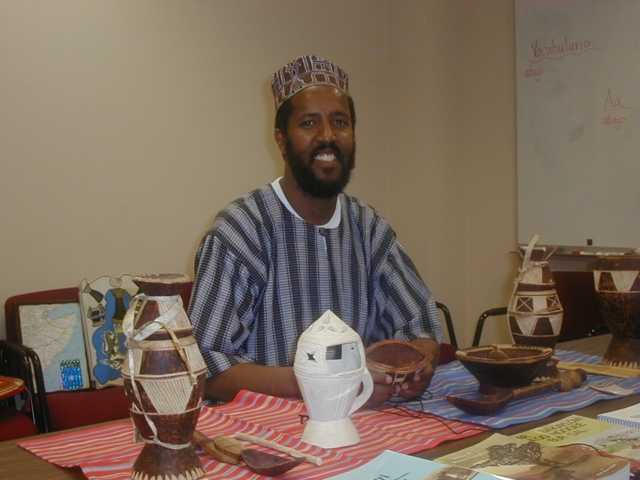Photograph of St. Paul ESL teacher Abdisalam Adam in his office, June 24, 2004.