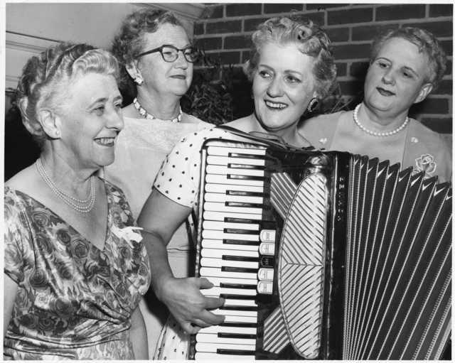 Photograph of Coya Knutson playing her accordion