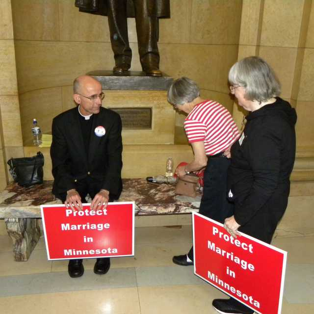 Color image of Demonstrators gather at the State Capitol in St. Paul to show their support of Minnesota Amendment 1. Photographed on May 20, 2011, by Flickr user Tom Morris.