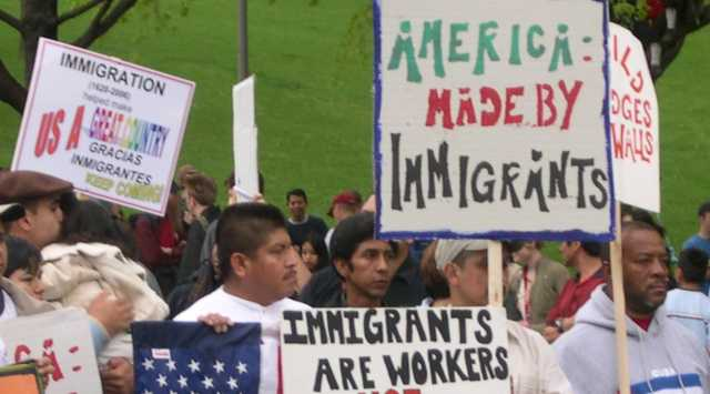 Color image of demonstrators gathering in St. Paul to show their support for immigrants' and immigrant-workers' rights, 2006. Photographed by Mary Turk.