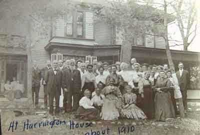 Black and white photograph of a group of people at the Harrington-Merrill House, c.1910.