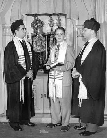 Photograph taken at the bar mitzvah of Leland Fleisher at Adath Jeshurun Synagogue in Minneapolis.