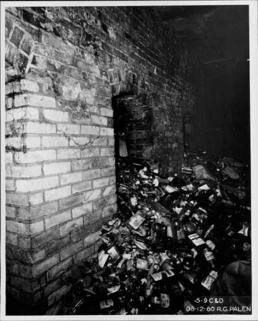 Bottle dump in the basement of the Pioneer Hotel