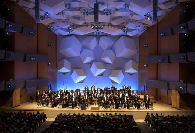 Color image of the Minnesota Orchestra on stage performing a Beethoven Marathon, 2016.