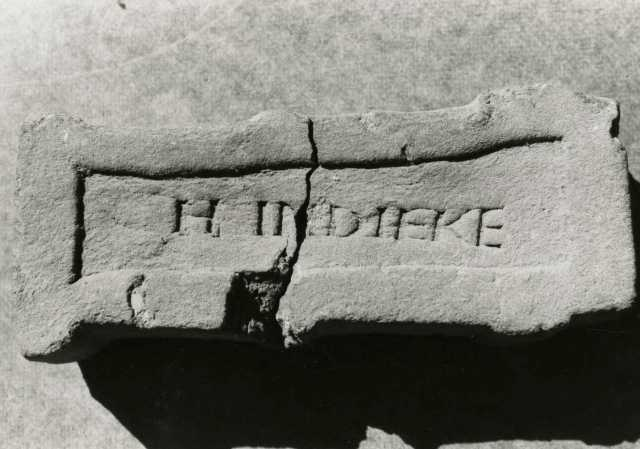 Black and white photograph  of a brick manufactured at the Imdieke brick yard between 1883 and 1915 in Meire Grove.
