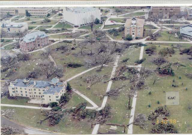 Color image of tornado damage in St. Peter, Minnesota, 1998. Image shows trees down and damage to a number of buildings.