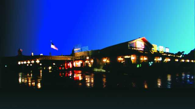 Color digital print of the exterior of Chanhassen Dinner Theatres at night.