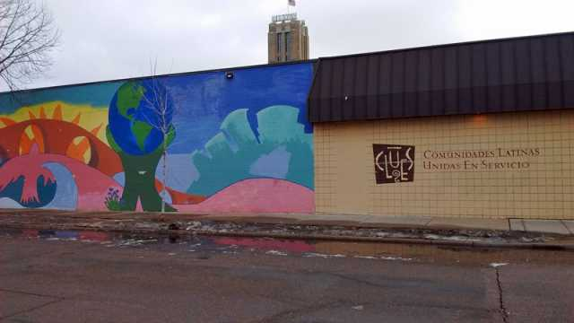 Color image of the exterior of the Minneapolis location of Comunidades Latinas Unidas en Servicio (CLUES), a nonprofit social service organization for Latinos, at 720 East Lake Street in Minneapolis, February 20, 2016. Photographed by Lizzie Ehrenhalt.