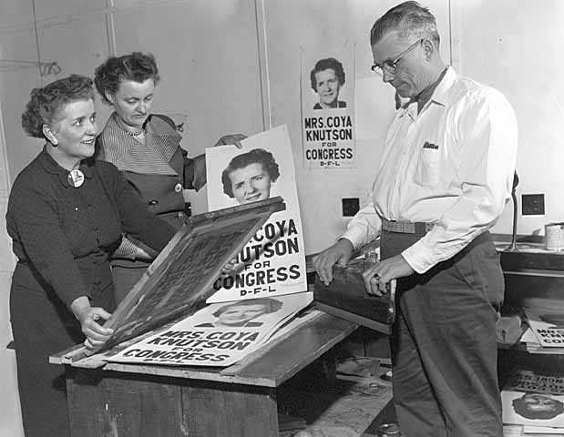 Photograph of Coya Knutson with campaign posters