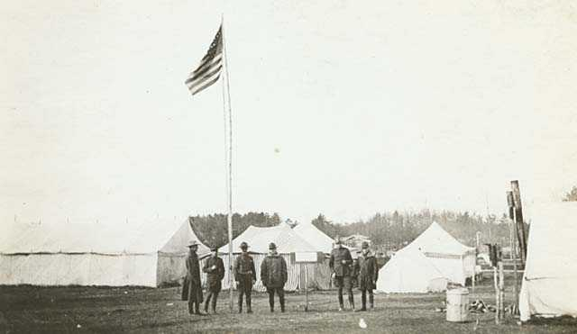Black and white photograph of a Minnesota Home Guard Camp during the fires of 1918.