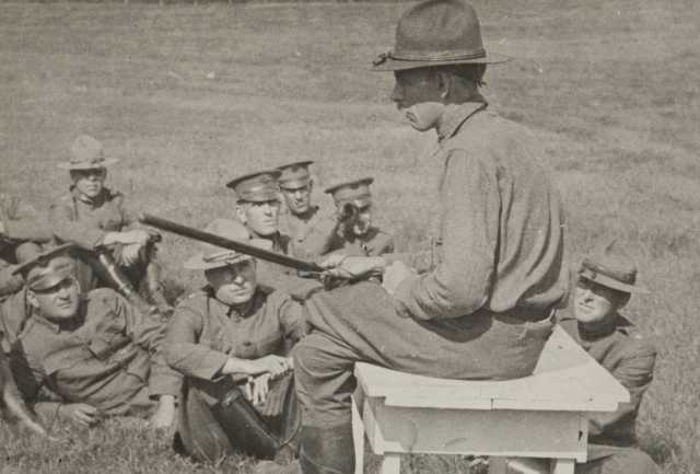 Black and white photograph of Colonel Bellows of the Minnesota National Guard giving instruction in riot stick usage. Camp Lakeview, Lake City, Minnesota, September, 1918.