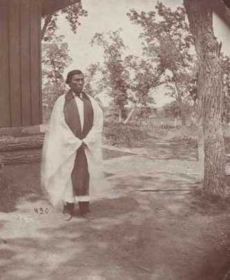 Black and white photograph of Enmegahbowh (Reverend John Johnson), c.1885.