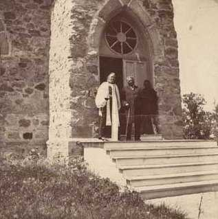 Black and white photograph of Enmegahbowh (Reverend John Johnson) and Bishop Whipple, c.1898.