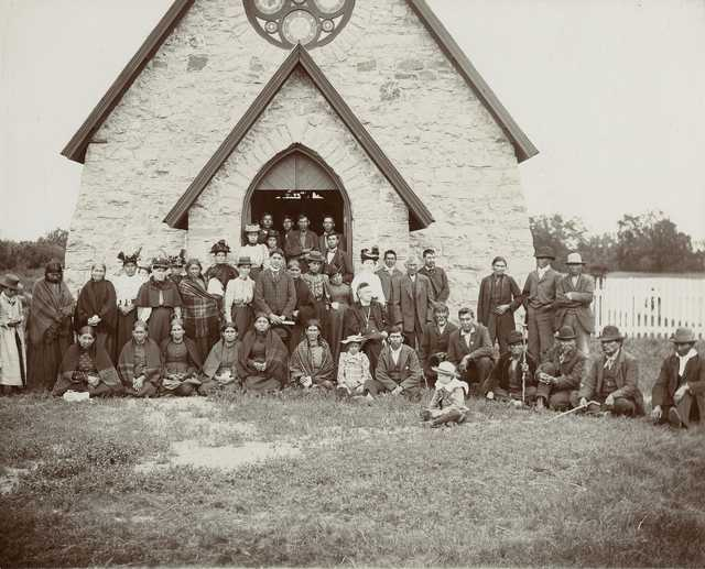 Black and white photograph of Bishop Whipple and others at St. Cornelia's Church, Morton, c.1895.