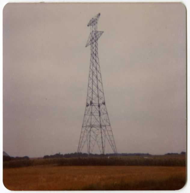 Workers finish connecting the upper and lower portions of a high-voltage power-line tower in Grant County, Minnesota, 1976–1978.