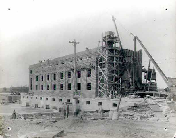 Construction of the power plant at the north end of the Coon Rapids Dam.