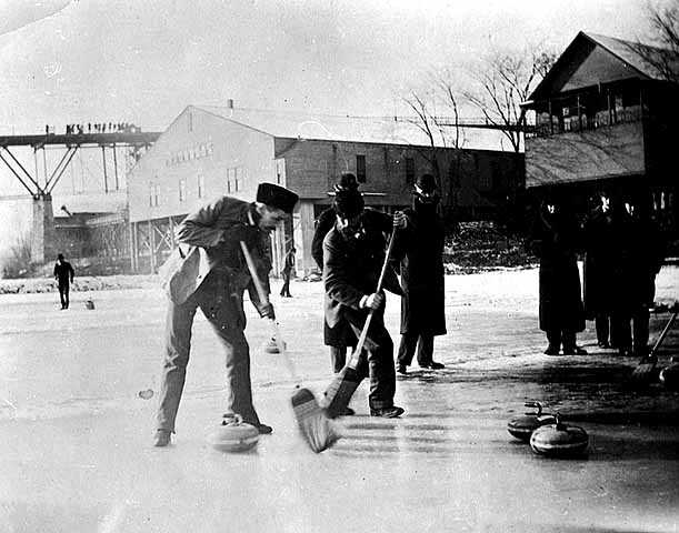 Action shot of curling on the Mississippi River.