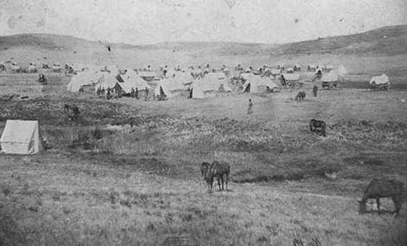 Black and white photograph of the camp of Brackett's Battalion near Fort Berthold, Dakota Territory, 1865.