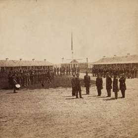 Black and white photograph of General George N. Morgan reviewing Veteran Reserve Corps troops at Fort Snelling, 1864.