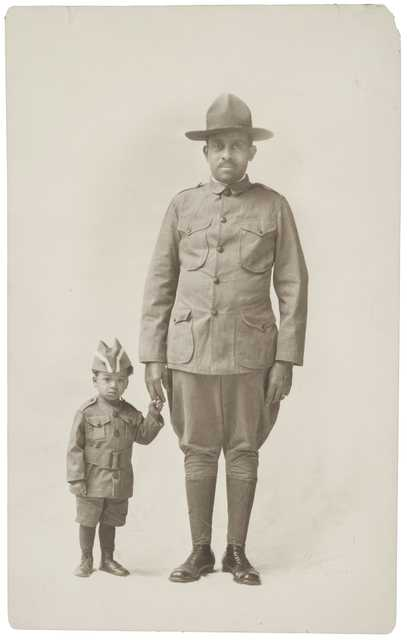 Black and white photograph of Dr. O.D. Howard Sergeant in the Sixteenth Battalion of the Minnesota Home Guard and his grandson, Howard Maxwell, 1918.