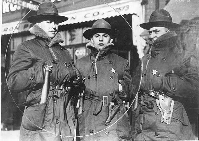Black and white photograph of three members of the Minnesota Home Guard during the Streetcar workers strike of 1917. The stars they wear designate them as special deputy sheriffs of Ramsey County.