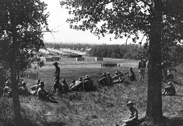 Black and white photograph of officer candidates overlooking encampment at the Officers' Training Camp, Fort Snelling, 1917.