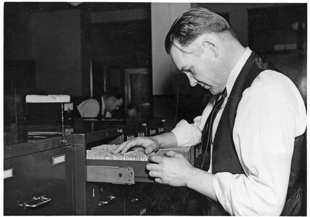 Photograph of a St. Paul Police worker revising police records