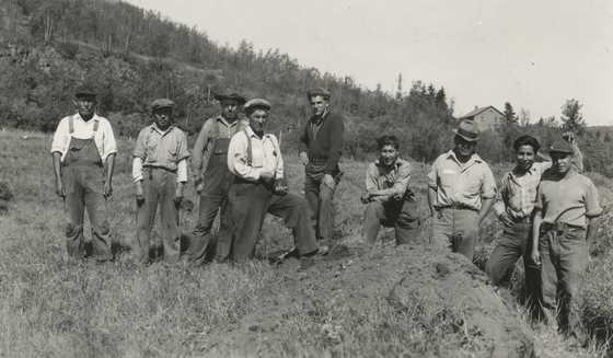 Black and white photograph of Indian Civilian Conservation Corps crew on the stockade site at the end of the first day of work, Grand Portage, Minnesota, 1937. Photographed by Willoughby Maynard Babcock, Jr.