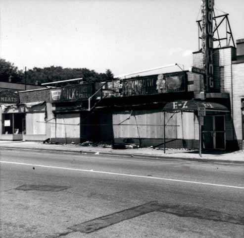 Black and white photograph of boarded-up storefronts on Plymouth Avenue in North Minneapolis, July 1967. Photographed by Twiggs.