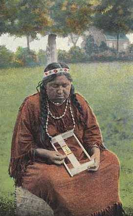 Colorized picture postcard featuring a Dakota woman making beadwork, c.1930.
