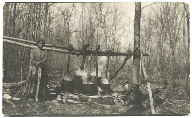 Ojibwe women making maple sugar at Cass Lake