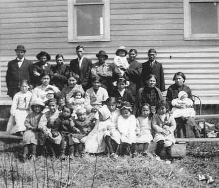 Black and white photograph of an Indian Congregation, Sawyer, Fond du Lac Reservation, 1909–1912.
